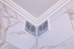 Midway Cinema - plastic whiter air circular vent window in bathroom, wall ventilation grate